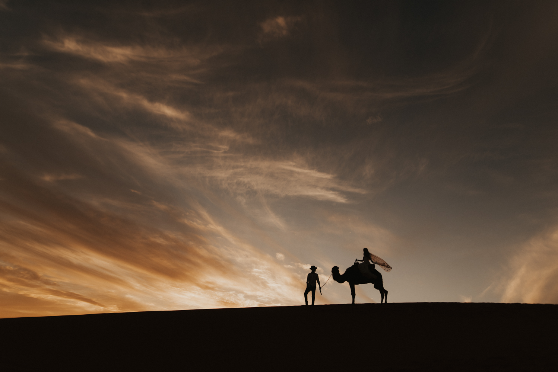 bride on camel at sunset
